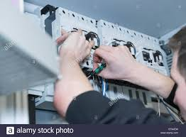 electrician fixing cable in distribution fusebox munich bavaria electrician fixing cable in distribution fusebox munich bavaria