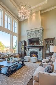 fireplace lighting ideas. large living room with two story windows gorgeous lighting area rug stone fireplace ideas