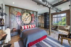 Sleep in the theme day and night, as nautical overtones mix with this  industrial sleeping space. Large metal pipes snake across the room, ...