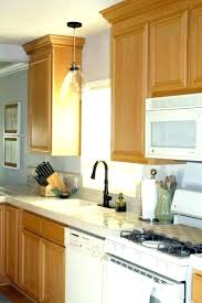 wall mounted light over kitchen sink kitchen sink pendant light height over wall mounted light over