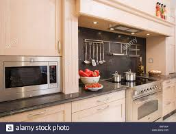 Modern Microwave microwave oven in pale wood fitted unit in modern kitchen with 2085 by guidejewelry.us