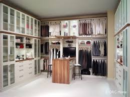 walk in closet in eggshelf ivory and canyon plum thick forterra shelveing using a euro drawer style
