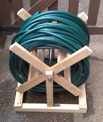 garden hose box. Ideas, Diy Wooden Hose Storage For Garden Appliances Plus Long Blue Storages: Useful At Once Really Decorative In Cari. Box