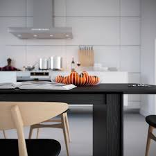 White Symmetrical Kitchen Wire Fruit Basket Oranges Against A Monochrome  Backdrop