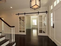 Pocket Door Alternatives Entry Traditional with Circa Lighting Caged Lamp