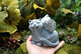 angel cat statue basking in the