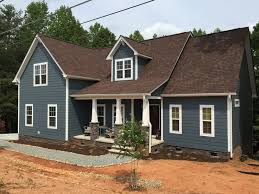 Need exterior house siding color ideas? Introducing the Decorologist's new  color sets for brown roofs