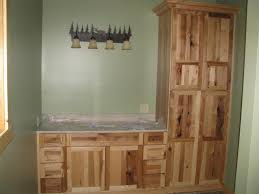bathroom linen closet and cabinet with wood color and straight pattern