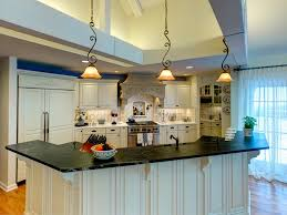 custom kitchen lighting. The Kitchen Has Many Amenities Including A Built-in Refrigerator, Commercial Range, Custom Lighting