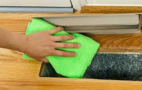how to clean your own air ducts a person wiping the inside of their air