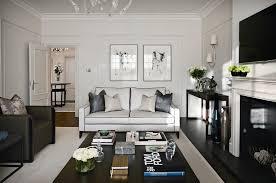 the hampstead apartment trendy formal living room photo in london with white walls dark hardwood floors blue dark trendy living room