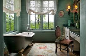 view in gallery serene victorian bathroom with light green walls unique rug and vintage bathtub design