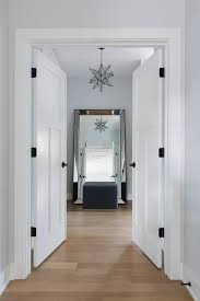 walk in closet with moravian star pendant and leaning floor mirror