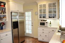 glass front upper cabinets in white kitchen
