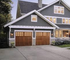 garage doors menardsBlue with wood garage door  lake home  Pinterest  Wood garage