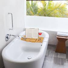 bamboo bathtub caddy with extending sides and adjule book holder by toilettree s 34 95
