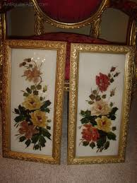 pair of victorian paintings of flowers on glass