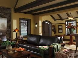 craftsman style living room with leather sofa and beamed ceilings