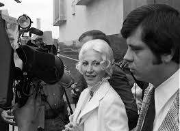 Priscilla Davis is surrounded by reporters | UTA Libraries Digital Gallery