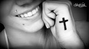 значение тату крест объединенный традициями