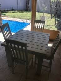 4 seater wooden garden table and chairs good condition