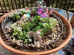 how to build a fairy garden. Learn How To Build A Fairy Garden With Kids In Clay Pots. This Activity -