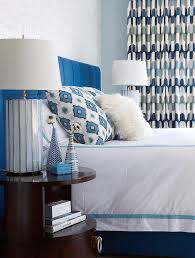 blue headboard with white and blue bedding