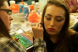 cographer kathleen schuler applies junior olivia neal s eye makeup before the final dress rehearsal of seussical