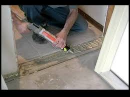 installing front doorHow to Replace a Garage Entry Door  Gluing the Threshold of a