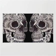 ornate twin skull head area rug