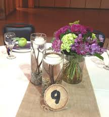 Wedding Centerpiece Using A Trio Of Glass Cylinder Vases, Floating Candles,  Small Pebbles,