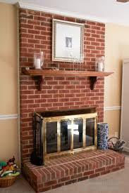 fireplace with shelf and protection glass
