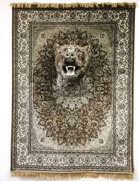 debbie lawson shapes immersive animal sculptures out of traditional persian rugs