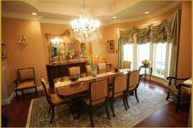 formal dining room decor inspiration with chandelier and traditional rug