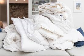 pacific coast european down comforter. Interesting Coast A Small Mountain Of Comforters Piled Atop Each Other On A Couch As Part  Our With Pacific Coast European Down Comforter O