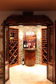 wine barrel chandelier wine cellar mediterranean with barrel french doors stone floor stone wall