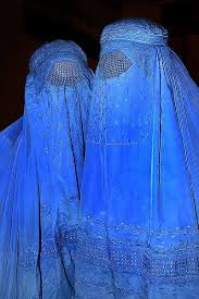 s taliban laws the iconic afghan blue burqa a full body garment built in skull cap and shuttlecock eye grille