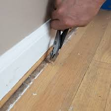 removing a staple from hardwood flooring with pliers
