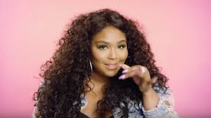 Decorative Image of Lizzo depicting an artist that song embodies hot girl summer