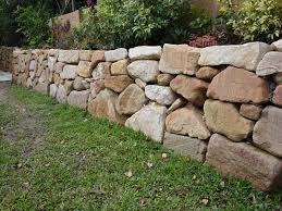 hand placed sandstone rock retaining wall ashmore