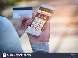 Man betting on sports, holding smaart phone with working online betting  mobile application Stock Photo - Alamy