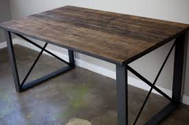 a hand made reclaimed wood dining table desk