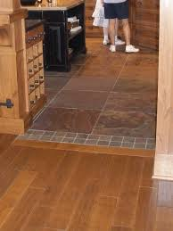 amazing laminate wood tile i love the transition from the wood to the laminate home ideas