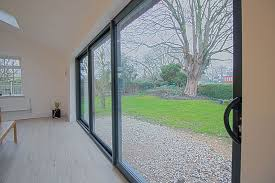 essential triple panel sliding door chester