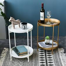 Glass top coffee tables are another great option as they help to create the illusion of more space. Creative Nordic Minimalist Iron Double Layer Small Coffee Table Living Room Small Round Table Mini Cute Round Small Side Table Hot Sale Aed79d Cicig