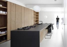 a foscarini gregg pendant hangs above the kitchen table the island is made of oak modern counter o48 counter