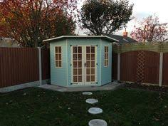 summer house lighting. Light Blue/green Pent Roof, Corner Summerhouse. Perfect For Setting Some Chairs Inside Summer House Lighting