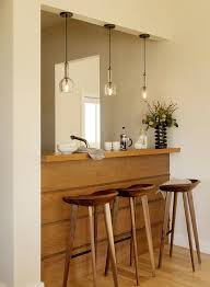 view full size modern kitchen featuring trio fo modern glass pendants over breakfast bar