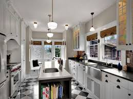 black and white floor tile kitchen. love everything about this kitchen. the lighting, paint color, color of black and white floor tile kitchen
