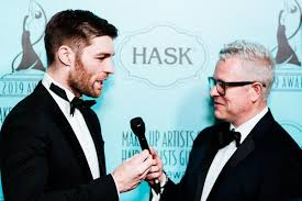 actor liam mcintyre left speaks with hairdresser monte c haught